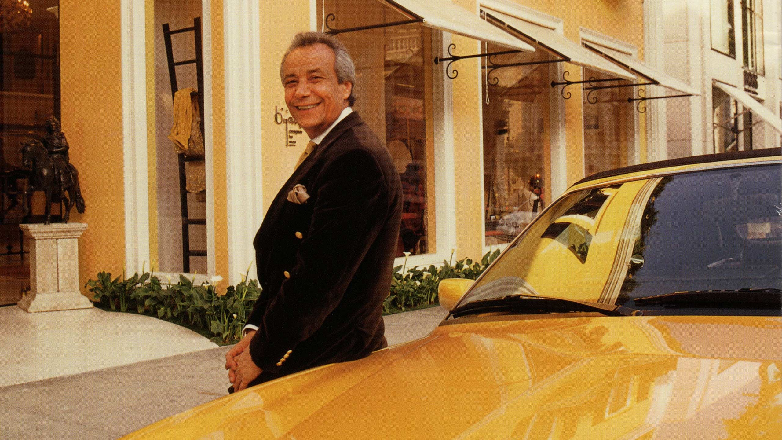 Bijan posing in front of his store in Beverly Hills.