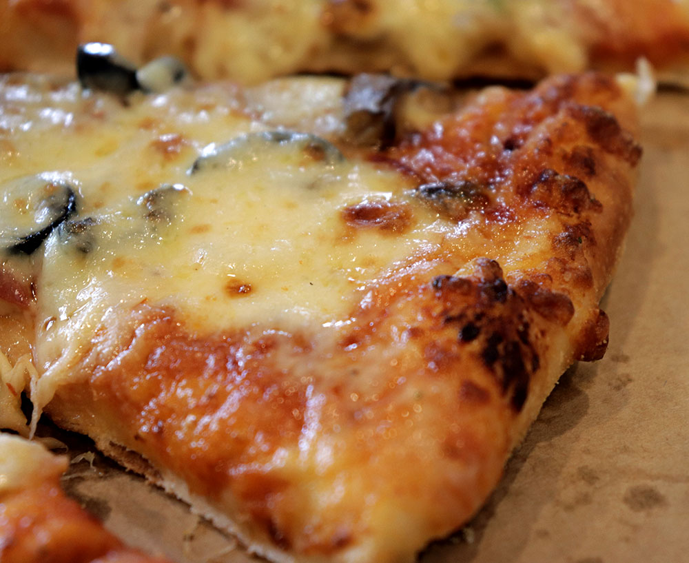 The cheese gives the pizza crust an extra crunch.